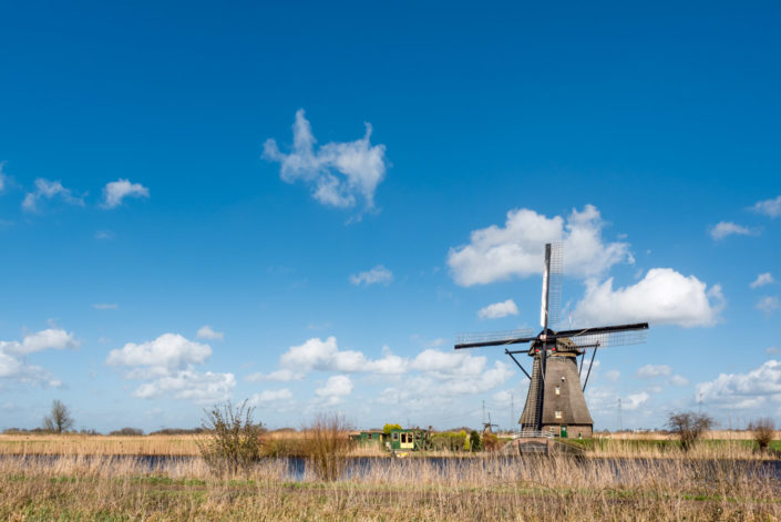 Windmill and blue sky in Kinderdijk, Rotterdam, Netherlands