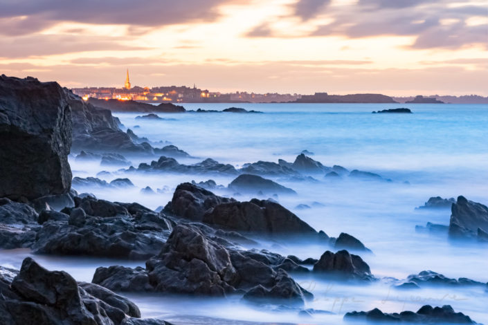 Saint-Malo after sunset with rock and sea long pose, Brittany, France