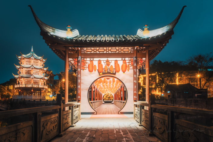 Baihuatan traditional chinese bridge illuminated at night in Chengdu, Sichuan province, China