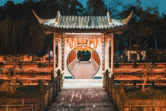 Baihuatan chinese traditional bridge illuminated with chinese lanterns at night in Chengdu, Sichuan province, China