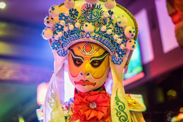 Chinese artist perform traditional face-changing art or bianlian onstage at Chunxifang Chunxilu, Chengdu, Sichuan Province, China