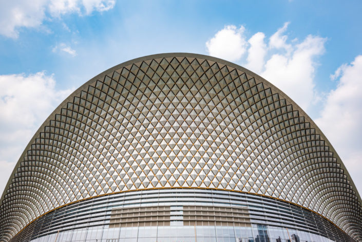 Chengdu open air music park modern building with futuristic architecture against blue sky, Sichuan province, China