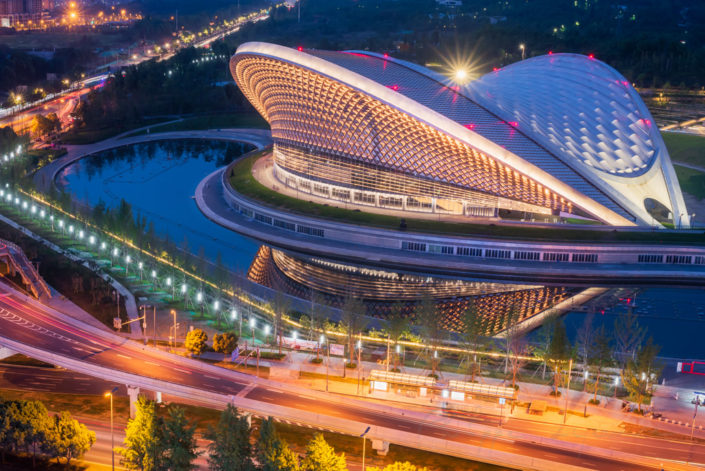 Chengdu open air music park modern building with futuristic architecture aerial view at blue hour, Sichuan province, China
