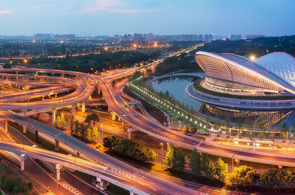 Chengdu open air music park modern building with futuristic architecture and interchange aerial view panorama at blue hour