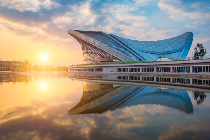 Chengdu open air music park modern building with futuristic architecture reflecting in a pond, Sichuan province, China