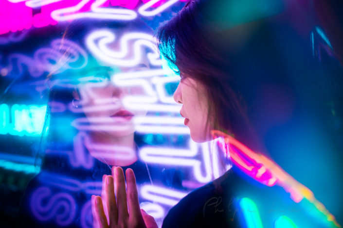 Neon portrait of a young chinese woman in Chengdu, Sichuan province, China