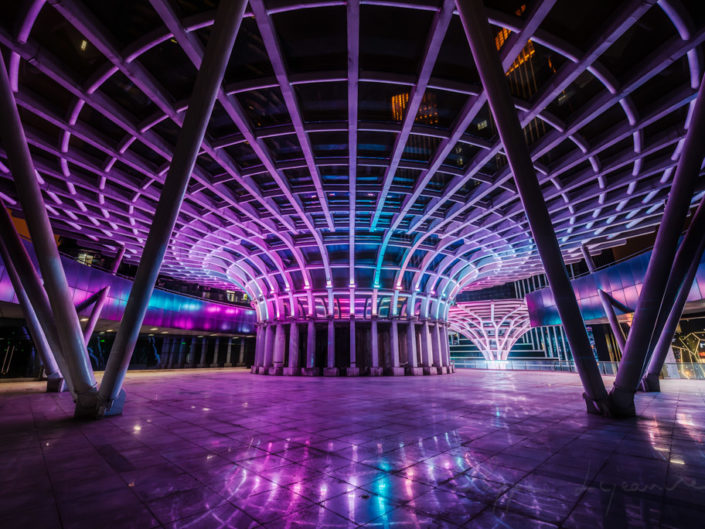 Blog – Umbrella shape architectural feature illuminated with multicolor lights at night in Chengdu