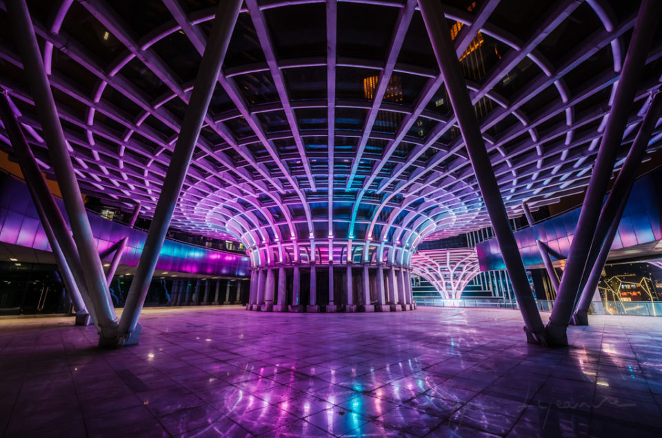 Umbrella shape architectural feature illuminated with multicolor lights at night in XinNanZhongXin building, Chengdu, Sichuan province, China