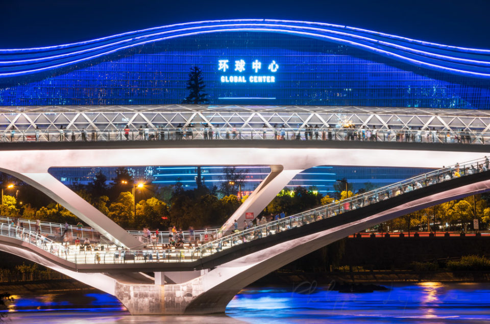 Wuchazi bridge above FuHe river illuminated at night against Global Center building in Chengdu, Sichuan province, China
