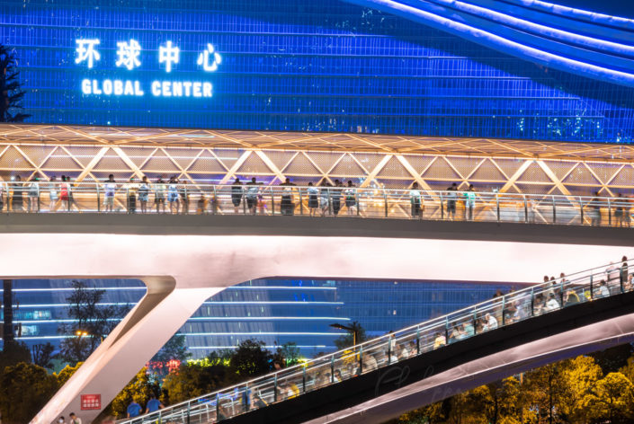 Wuchazi bridge above FuHe river illuminated at night against Global Center building in Chengdu, Sichuan province, China