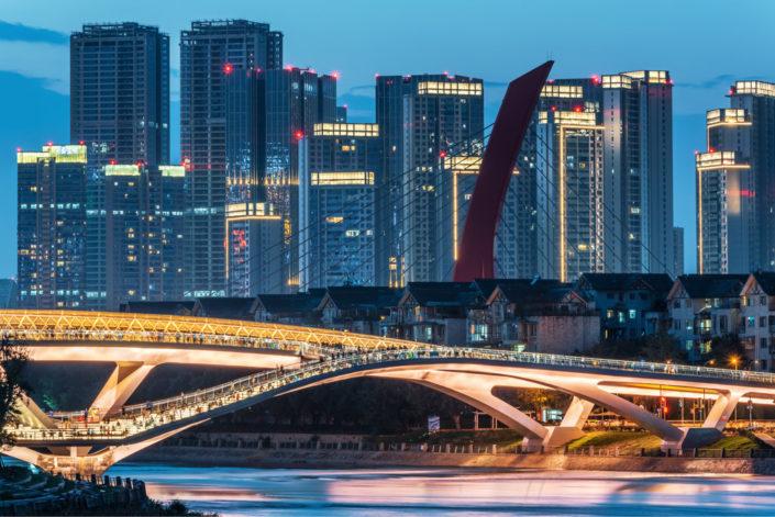 Wuchazi bridge and skyscrapers illuminated at night, Chengdu, Sichuan province, China