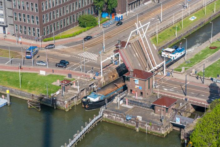 Bascule bridge opening in Westzeedijk street aerial view, Rotterdam, Netherlands