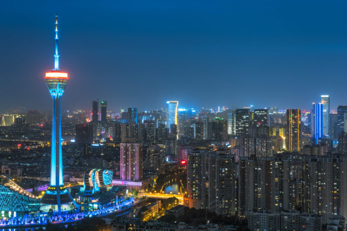 Chengdu skyline at night with the West Pearl 339 TV tower in blue, Sichuan province, China