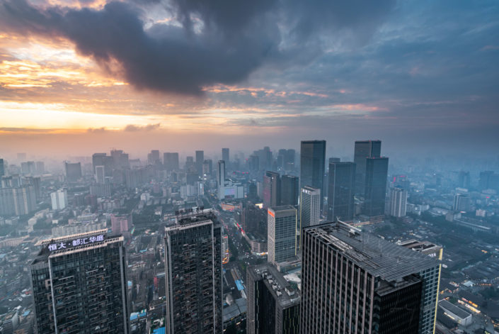 Chengdu backlight skyline aerial view with clouds on the city, Sichuan province, China