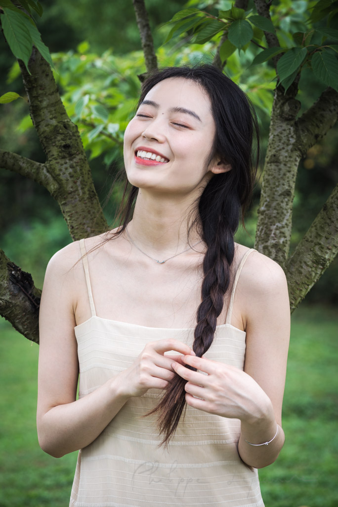 Chinese young woman portrait in nature, Chengdu, Sichuan province, China