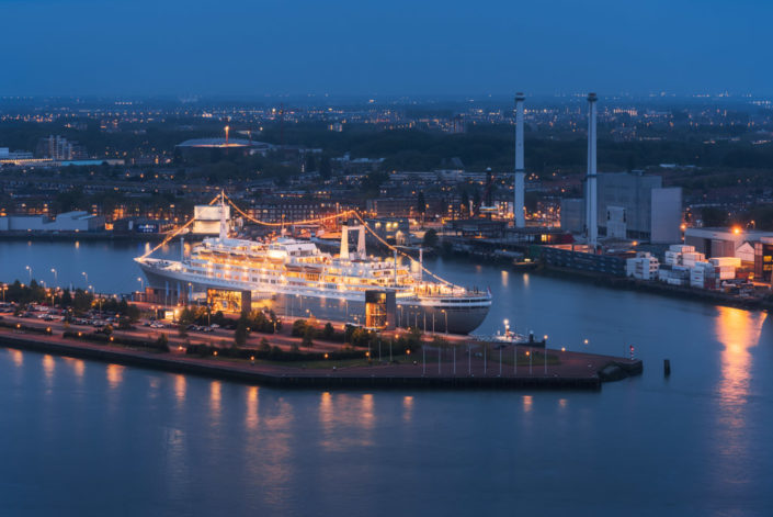 SS Rotterdam cruise ship illuminated at night aerial view, Rotterdam, Netherlands