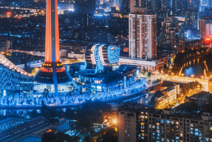 Chengdu West Pearl 339 TV tower illuminated at night aerial view, Sichuan province, China
