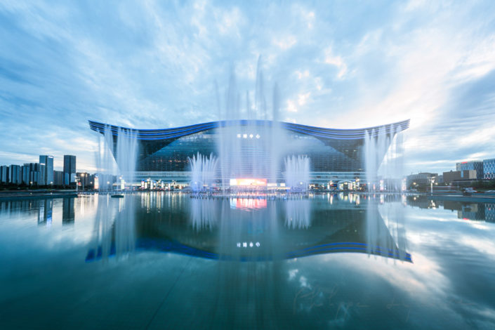New Century Global Center reflecting in a basin with fountains at sunset, Chengdu, Sichuan Province, China