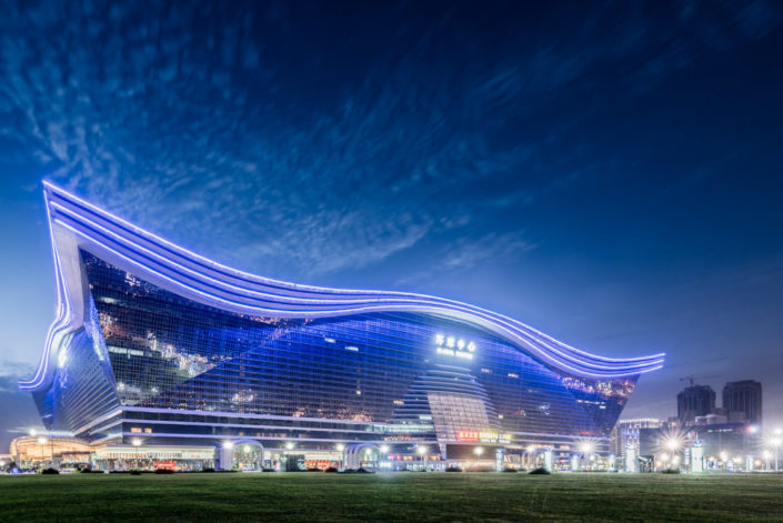 New Century Global Center at night colored in blue with a clear sky, Chengdu, Sichuan Province, China