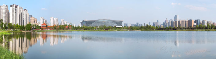 New Century Global Center reflecting in a lake panorama, Chengdu, Sichuan Province, China