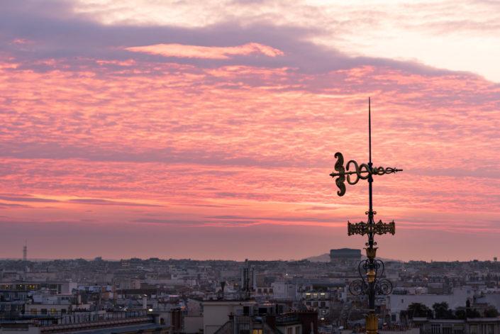 Decorative antenna against purple colored clouds in Paris, France