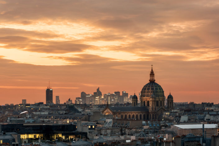 La Defense financial district and Saint-Augustin Church at sunset in Paris, France