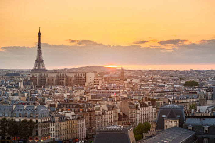Paris and Eiffel tower aerial view at sunset with orange sky, France