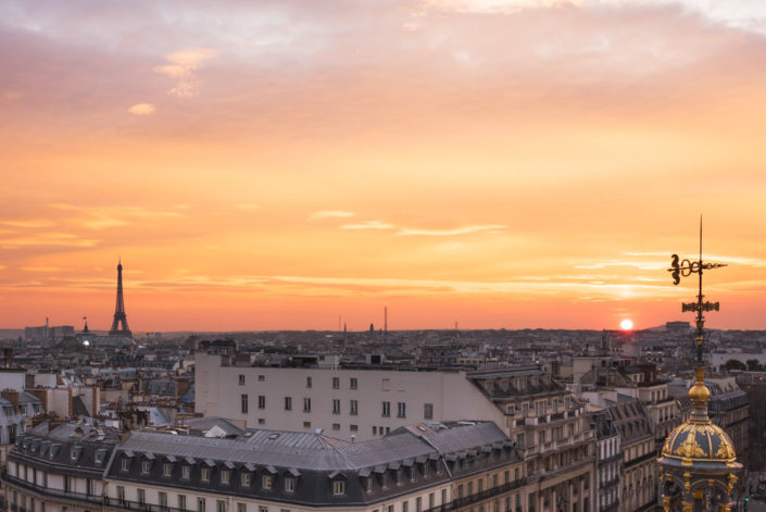 Paris roofs and Eiffel tower aerial view at sunset, France