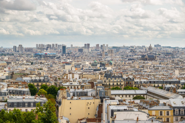 Paris roofs with a cloudy sky, France