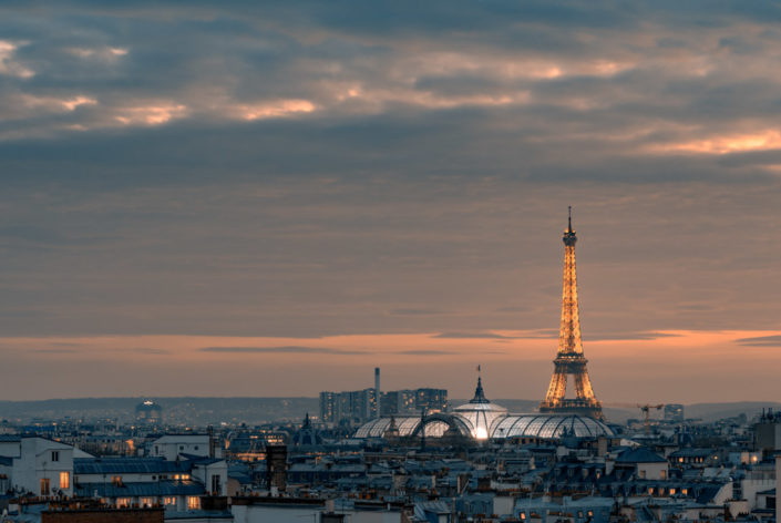 Paris skyline at sunsret with illuminated Grand Palais and Eiffel tower, France