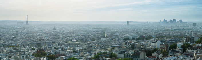 Paris skyline panorama at daylight with the Eiffel tower on the left and La defense business district on the right