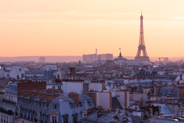 Paris skyline with Eiffel tower aerial view at sunset - purple colors, France