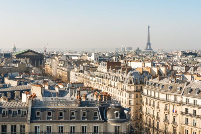 Paris skyline with Eiffel tower aerial view in daylight, France