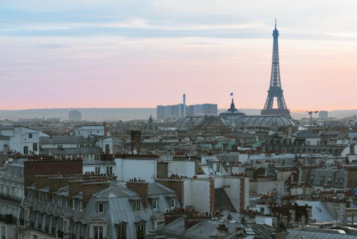 Paris skyline with Eiffel tower at dusk, France