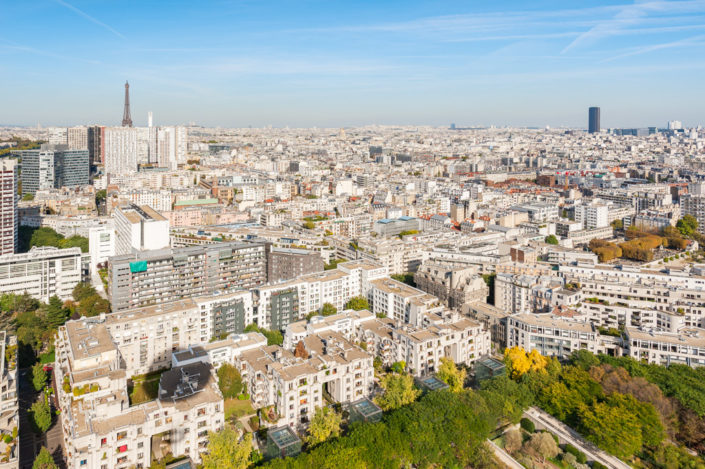 Paris with Eiffel tower aerial view from an air balloon on a sunny day, France