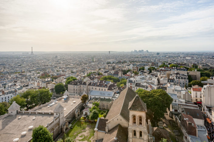 Paris with Eiffel tower and la Defense Financial district aerial view from Montmartre, France