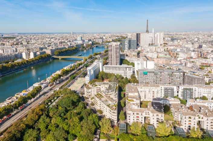 Paris with Eiffel tower and river Seine aerial view from an air balloon on a sunny day, France