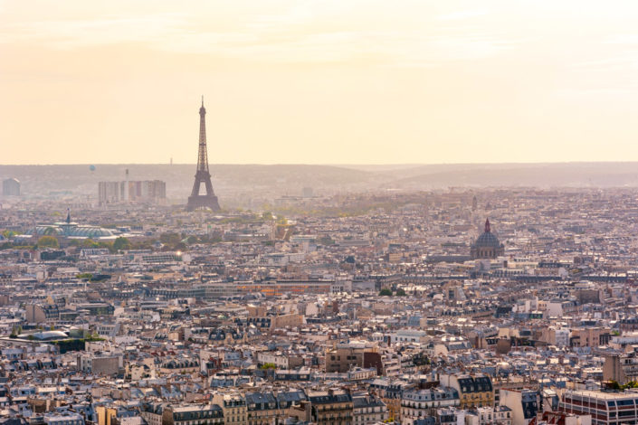 Paris with Eiffel tower in the haze aerial view from Montmartre