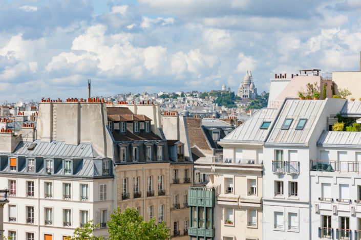 Parisian buildings with montmartre and the sacre-coeur in the background, Paris, France