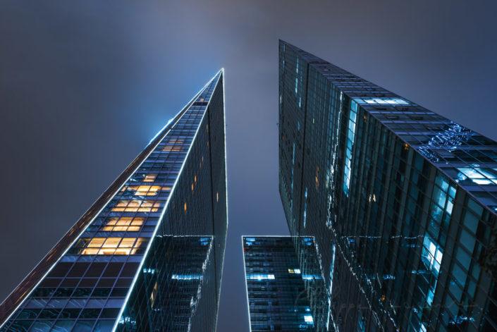 Hilton Hotel buildings facade illuminated at night in Guojiagou district, Chengdu, Sichuan province, China