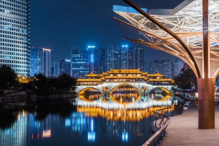 Anshun bridge and JinJiang YinYue place illuminated at night in Chengdu, Sichuan province, China
