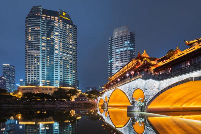 Chengdu Anshun bridge illuminated at night and reflecting in JinJiang river in Chengdu, Sichuan province, China