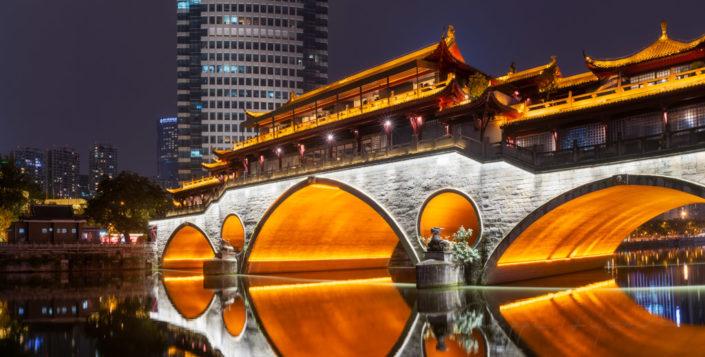 Chengdu Anshun bridge illuminated at night and reflecting in JinJiang river panorama in Chengdu, Sichuan province, China