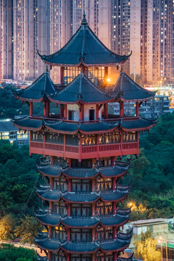 Chengdu Jiutian tower top against illuminated skyscrapers at night, Sichuan province, China