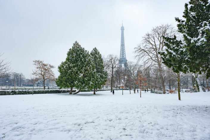 Eiffel tower under the snow from the Trocadero gardens in Paris, France