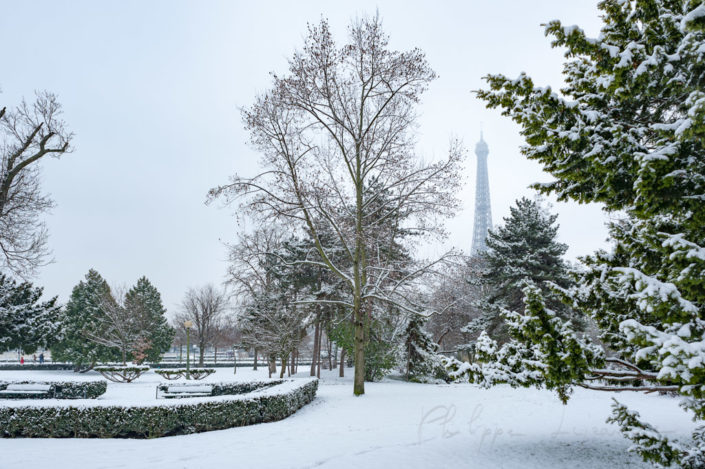 Eiffel tower in Paris under the snow from the Trocadero gardens in Paris, France