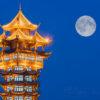 JiuTian tower illuminated at night and moon in Chengdu, sichuan province, China