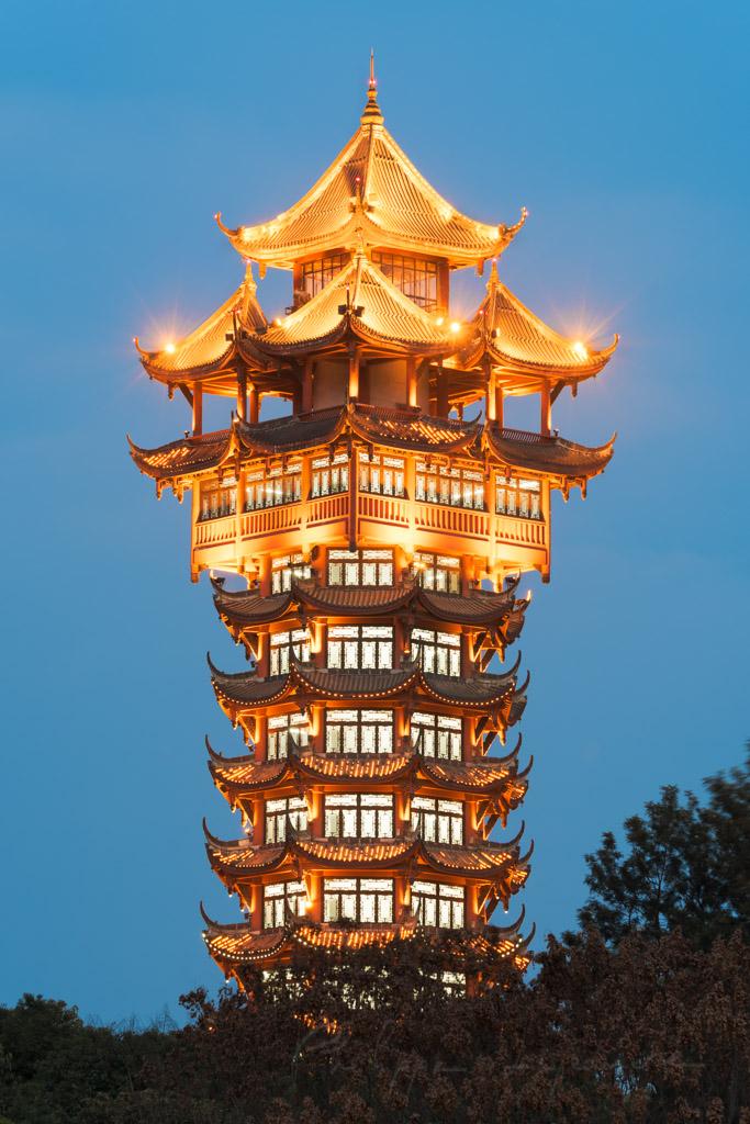 JiuTianLou tower illuminated at night in Tazishan park, Chengdu, China