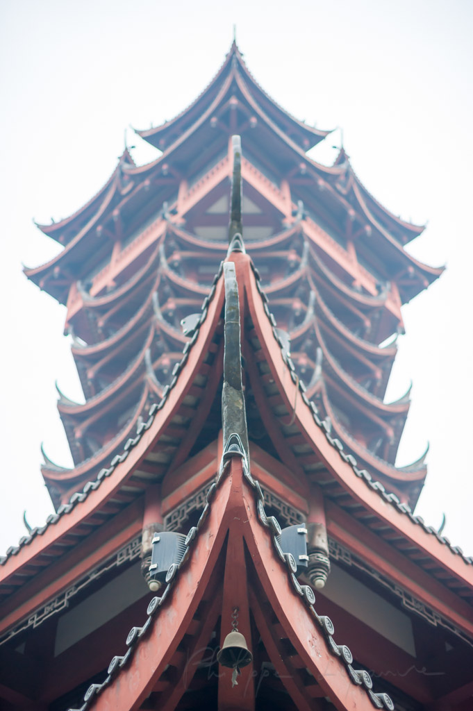 Jiutian tower against white sky low angle view in Chengdu, Sichuan province, China