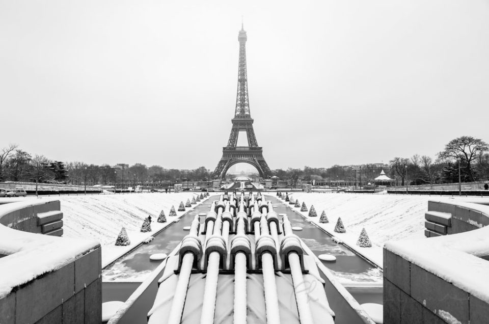 Eiffel tower under the snow from the gardens of the trocadero in Paris - black and white